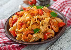 stock photo of shrimp  - Fettuccine pasta with shrimp - JPG