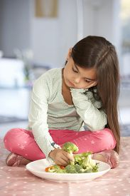 pic of fussy  - Unhappy Young Girl Rejecting Plate Of Fresh Vegetables - JPG
