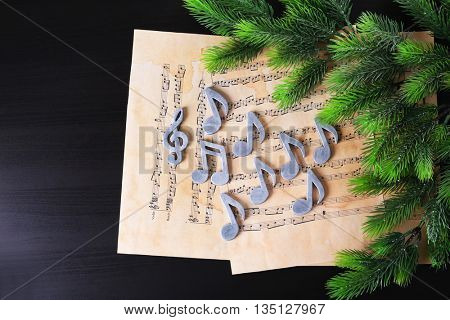 Christmas treble clef and music notes on paper background