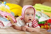 foto of babygro  - Baby girl with heap of baby - JPG