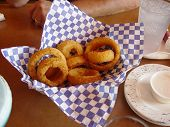 image of fried onion  - onion rings served on a speckled formica bartop - JPG