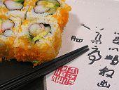 Постер, плакат: Фото суши на тарелке