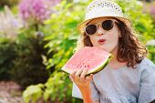 Summer Happy Child Girl Eating Watermelon Outdoor On Vacation, Wearing Sunglasses And Hat poster