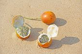 Three Orange Open Passion Fruit With Seeds. Passion Fruit Closeup On The Beach, On The Sand And On T poster