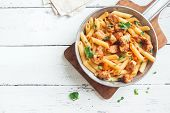 Penne Pasta In Tomato Sauce With Chicken,  Parsley In Pan. Chicken Italian Penne Pasta Over White Ba poster