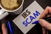 Conceptual Hand Writing Showing Irs Scam. Business Photo Text Warning Scam Fraud Tax Pishing Spam Mo poster