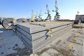 stock photo of shipbuilding  - packed rolls and plate of steel sheet - JPG