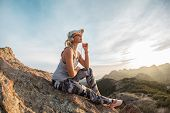 Music Lover At The Peak Of The Huge Mountain, Outdoor Leisure Quality Time, Pensive Look. poster