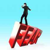 Businessman Balancing On 3d Red Fear Word Falling. Concept Of Courage, Overcoming Fear And Adversity poster