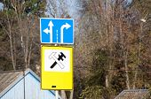 Yellow Sign Of Car Maintenance, Blue Sign Indicating A Possible Direction Of Travel. Pointers On Rus poster