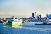 Modern Cruise Motor Ship Is Arriving To Port In Tallinn, Estonia. European Cityscape, Modern Buildin poster