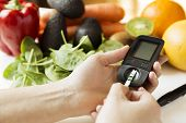 Diabetes Monitor, Diet And Healthy Food Eating Nutritional Concept With Clean Fruits And Vegetables  poster
