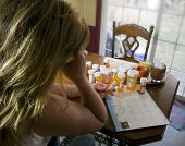 picture of drug addict  - A woman struggling with all her medication - JPG