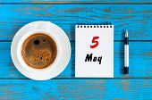 May 5th. Day 5 Of May Month, Calendar Written On Morning Coffee Cup At Blue Wooden Table, Top View.  poster