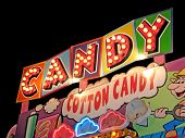 stock photo of candy cotton  - Neon cotton candy & candy sign at carnival stand