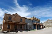 stock photo of forty-niner  - Wooden buildings in an abandoned American western town - JPG