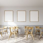 White Restaurant Interior With A Wooden Floor And Square Tables With White Wooden Chairs Near Them.  poster
