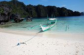 stock photo of olongapo  - A BancaBoat in looking over a Gorgeous Beach Scene El Nido Philippines - JPG
