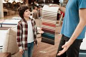 Man With Young Boy Chooses Color On Color Palette. Selecting Color Of Mattress On Color Palette Guid poster