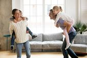 Laughing Parents Holding Kids On Back Giving Children Piggyback Ride Playing Together At Home, Cheer poster