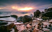 Ocean Water Splash On Rock Beach With Beautiful Sunset Sky And Clouds. Sea Wave Splashing On Stone A poster