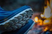 Close-up Of Rubber Boots On The Background Of The Evening Tourist Bonfire. View From The Side Of The poster