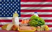Basic Food Groceries In Front Of America National Flag