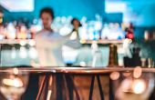Blurred Defocused Fashion Barman Shaking Cocktail At Speakeasy Retro Bar On Happy Hour - Mixology Co poster