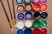 Set Of Paints For Painting With Brushes. Acrylic Paints In Tubes. Old Paint In Bottles. Paint Brushe poster