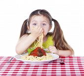 foto of table manners  - Beautiful girl eating pasta and meatballs with hands - JPG