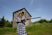 foto of old lady  - Shotgun Sally screams Get off my property while swinging around a rather large shotgun - JPG