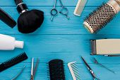 Professional Hairdresser Tools On Blue Background. Hairdressing Equipment And Copy Space. poster