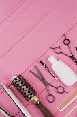 Hairdressing Tools On Pink Background. Professional Hairdresser Equipment Set. Space For Text. poster