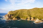 Knysna Heads. Looking From East Head To West Head With Caves In Featherbed Nature Reserve poster