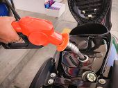 Filling Gasoline Into The Motorcycles Fuel Tank. poster