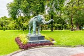 Elephant Statue In The Public Park, Bangkok, Thailand. Statue Is Placed On The Desk With Flowers Nea poster