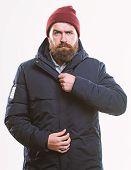 Man Bearded Hipster Stand In Warm Black Jacket Parka Isolated On White. Stylish And Comfortable. Hip poster