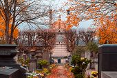 A View On Autumn Alley Of The Most Famous Cemetery Of Paris Pere Lachaise, France. The Crematorium O poster