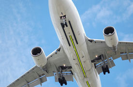 stock photo of mechanical engineer  - large low flying jet aircraft on landing approach - JPG