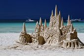stock photo of sos  - the sandy castle made on a snow - JPG