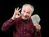 Elderly Man Showing Fan Of Money