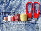 stock photo of tailoring  - Closeup to jeans pocket with tailor tools - JPG