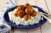 stock photo of cider apples  - Apple cider glazed chicken meatballs on rice - JPG