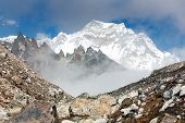 stock photo of cho-cho  - hungchhi peak and Chumbu peak above Ngozumba glacier from Cho Oyu base camp  - JPG