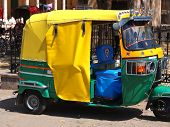 stock photo of rickshaw  - green and yellow rickshaw taxi in New delhi India - JPG