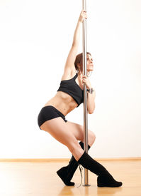picture of lap dancing  - The sports young woman and dancing pole - JPG