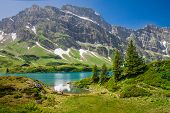 Hiking Around Truebsee Lake In Swiss Alps, Engelberg, Central Switzerland