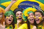 stock photo of enthusiastic  - Group of Brazilian soccer fans commemorating victory - JPG