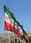 stock photo of iranian  - Series of Iranian Flags in a Windy Day - JPG