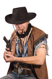 stock photo of wild west  - cowboy with revolver in his hand on white background - JPG